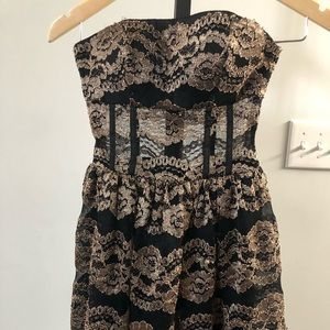 Bebe Strapless Black and Gold Lacy dress small